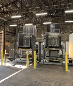 These two ExtractPack Plus horizontal liquid extraction balers are hard at work at a US canning facility.