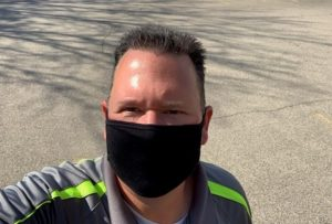 Harmony Enterprises' National Sales Manager, Nick Roberts, getting ready to conduct a site review, following mask mandates and social distancing guidelines during the pandemic.