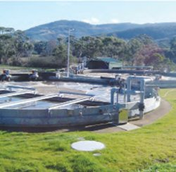 The PWTech Hybrid Biological Nutrient Removal (HBNR) process typically employs a twin circular tank design. The first tank (foreground) is an aerobicanoxic tank (AAT). The second tank (background) is an intermittently operated clarifier (IOC).