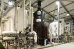 Integrated real-time gas analysis solution for moisture in ammonia industry