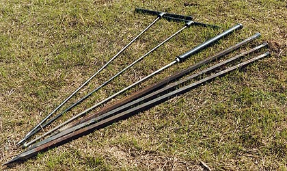 Use Digging Bars or Probe Rods like these.