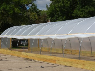 Hoop House with roll-up side curtains